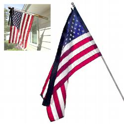 Half mast flag on a fixed pole at the Historical Society of Sarasota County