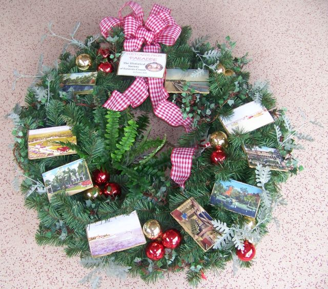 """Historical Society of Sarasota County presents """"Postcards from Paradise"""" our 2012 Festival of Wreathes entry at Sarasota Square mall."""