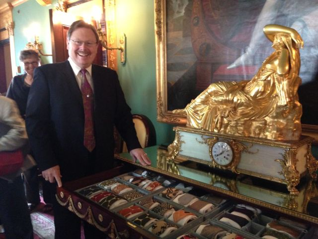 Ron McCarty, Curator of Ca'd'Zan, shows Historical Socierty members John Ringling's haberdashery