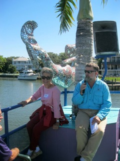 Norma Kwenski, Volunteer Extraordinaire, grabs the catbird seat on LeBarge, next to our commentator, always-captivating John McCarthy, one of Sarasota's leading historians.
