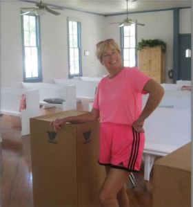 The Historical Society of Sarasota County Vic-=President Marsha Fottlerworks hard, even in pink shorts!