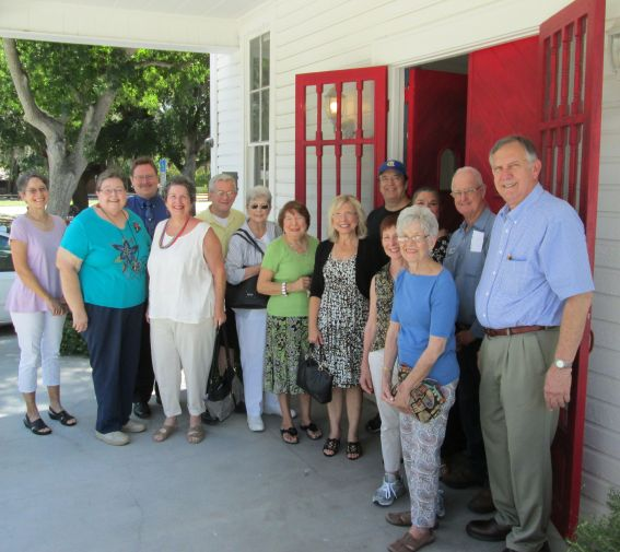Directors and supporters of the Historical Society of Sarasota County accept the gracious donation of a church bell from Jack Helm.
